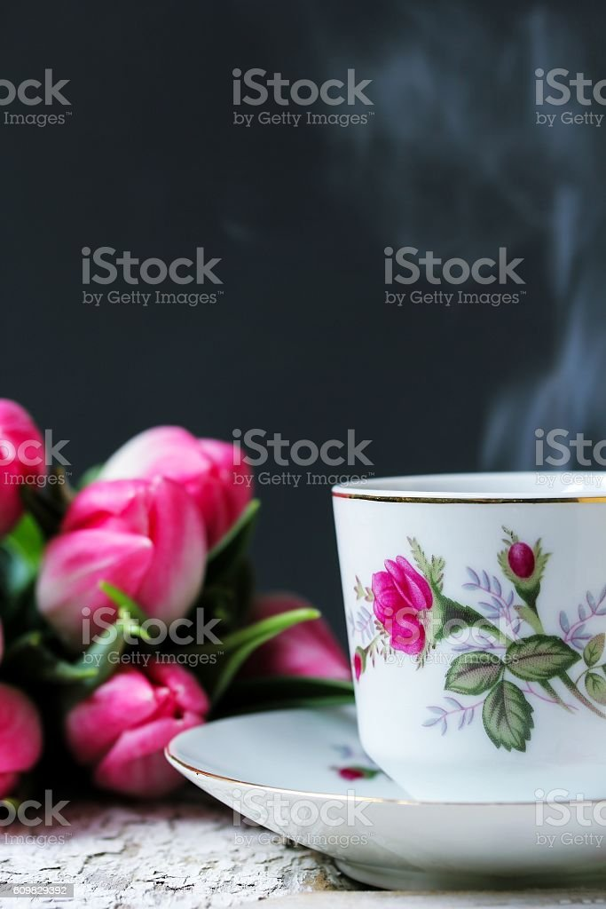 Steaming coffee cup or tea cup against dark background stock photo