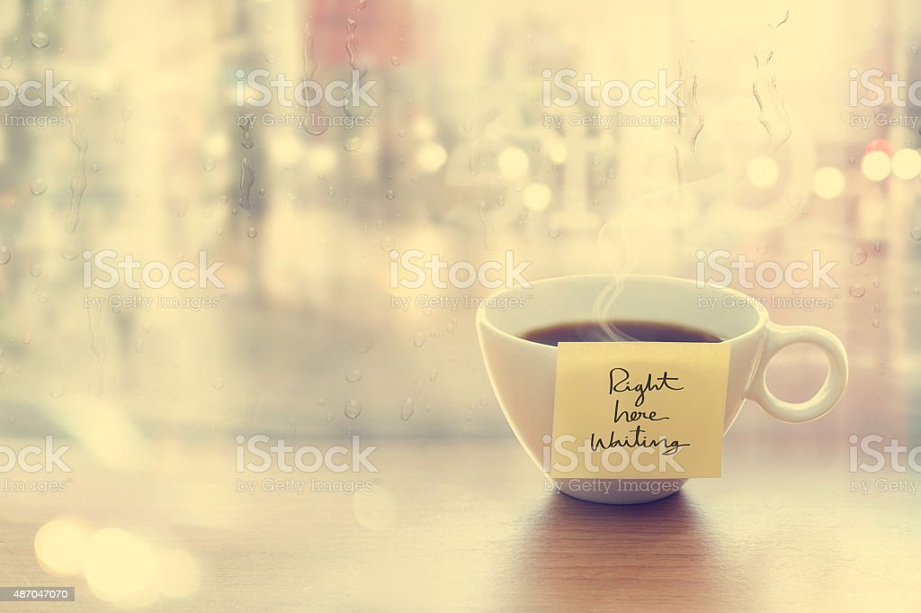 Steaming coffee cup with emotion message cup in coffee shop stock photo