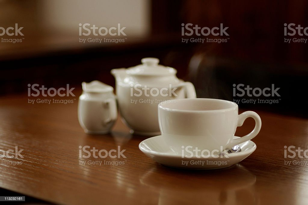 steaming cup of english tea on a restaurant table royalty-free stock photo