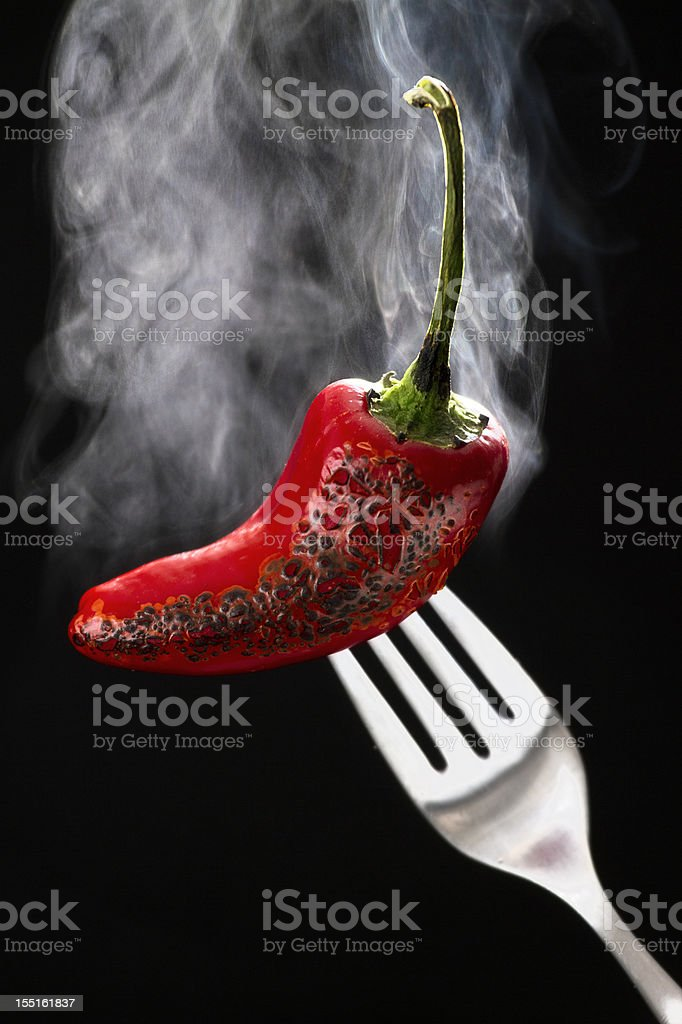 Steaming Hot Chili Pepper on a Fork royalty-free stock photo