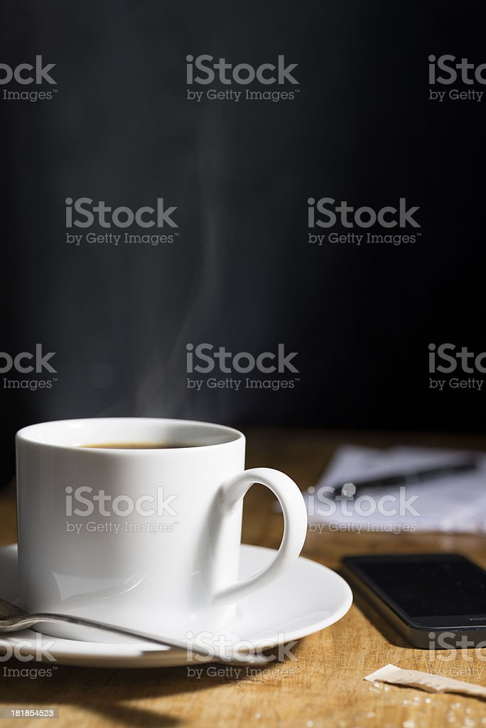Steaming Hot Coffee, Smartphone and Mail with Copy Space royalty-free stock photo