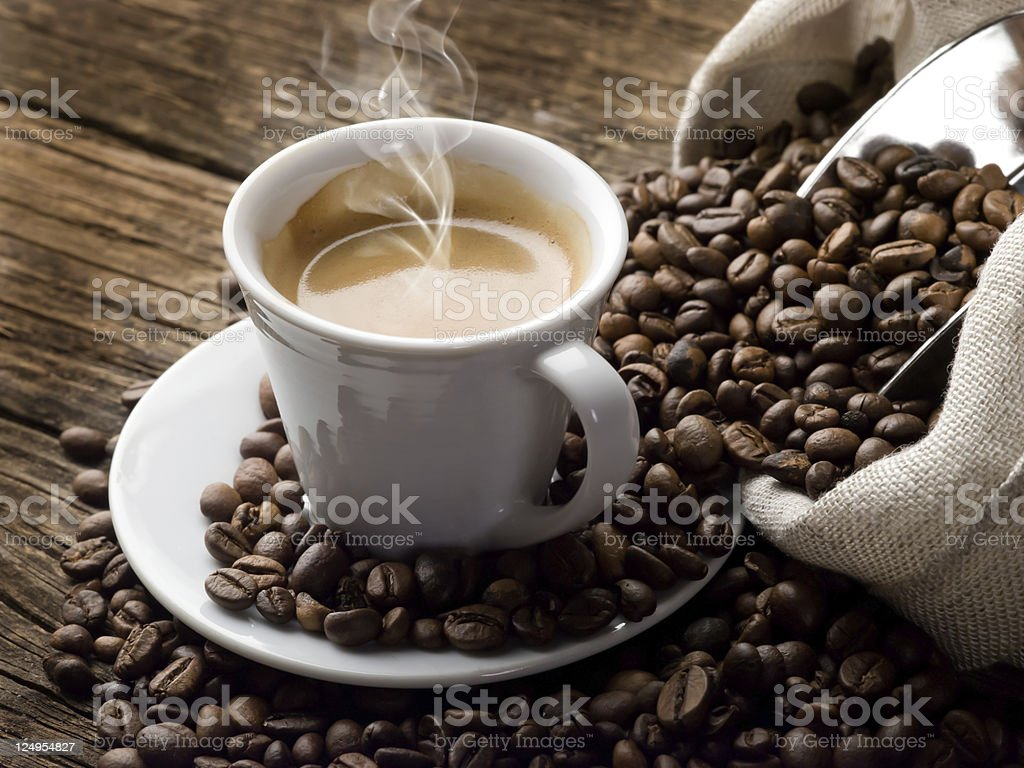 Steaming hot cup of coffee stock photo