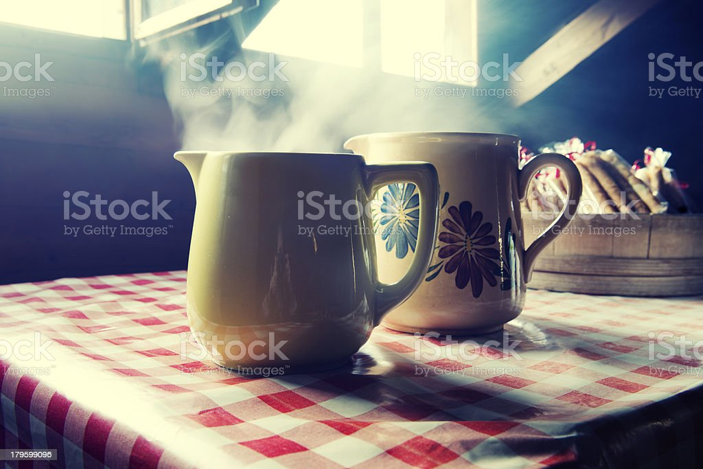 Steaming Hot Pitchers of Coffee royalty-free stock photo