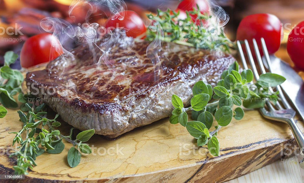 steaming hot steak royalty-free stock photo