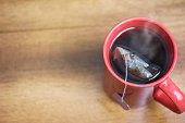 Steaming hot tea on wooden kitchen table from above