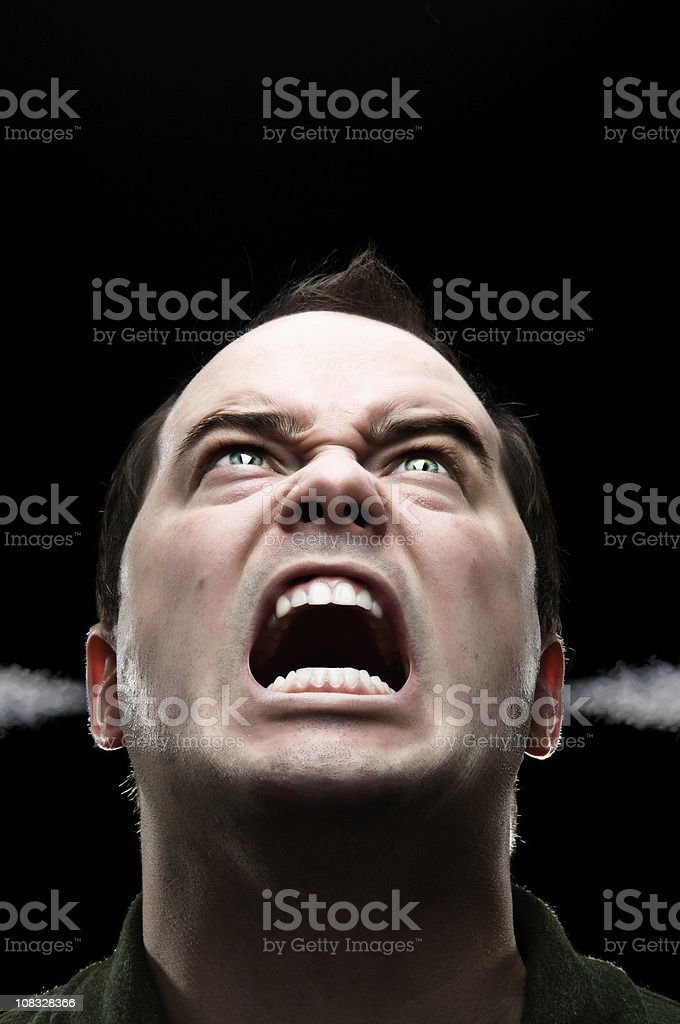Steaming Mad Man Isolated On Black royalty-free stock photo