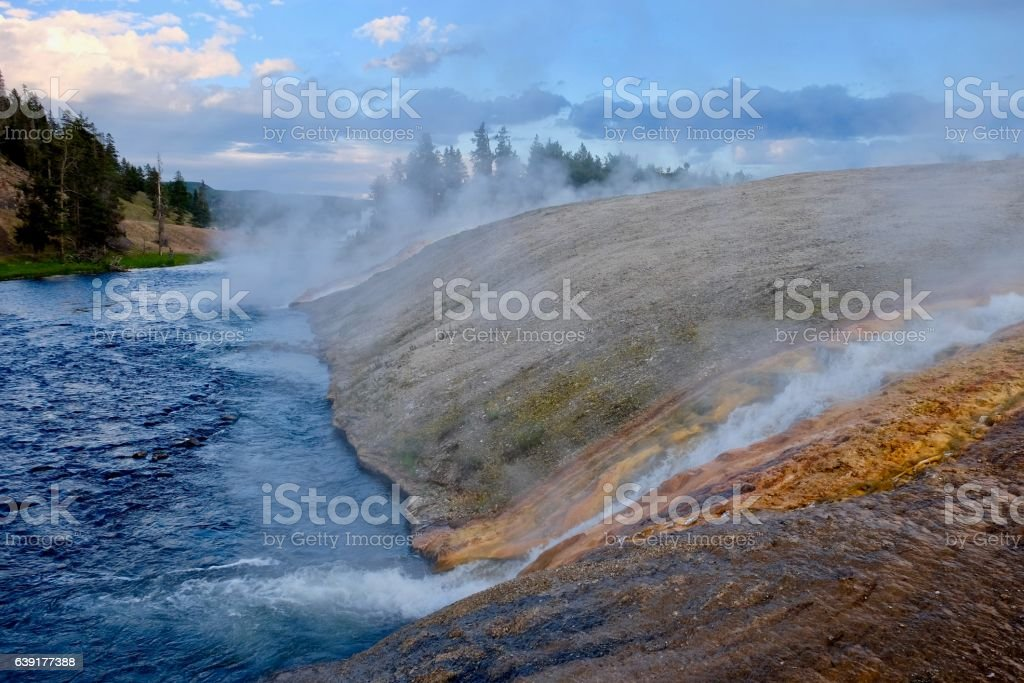 Steaming River of Yellowstone at sunset. stock photo