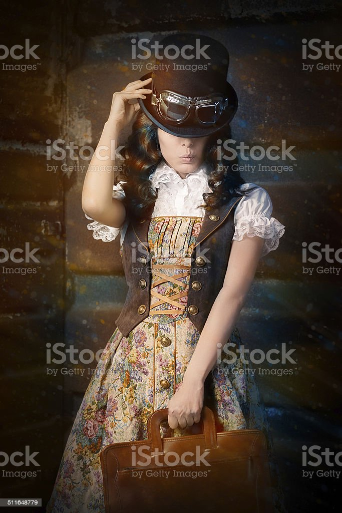 Steampunk Girl with Leather Portfolio Bag stock photo