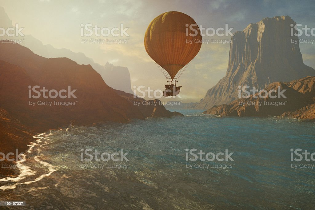Steampunk hot air balloon flying over canyon river stock photo