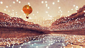 Steampunk hot air balloon flying over fantasy landscape