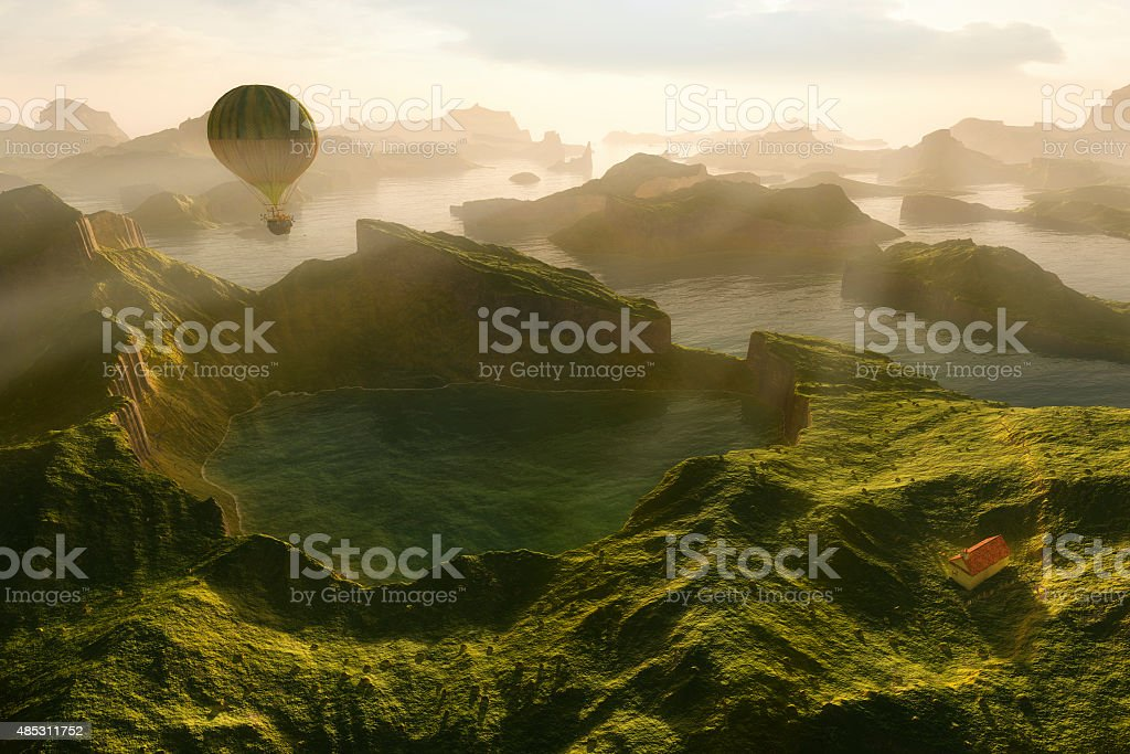 Steampunk hot air balloon flying over green fantasy landscape stock photo
