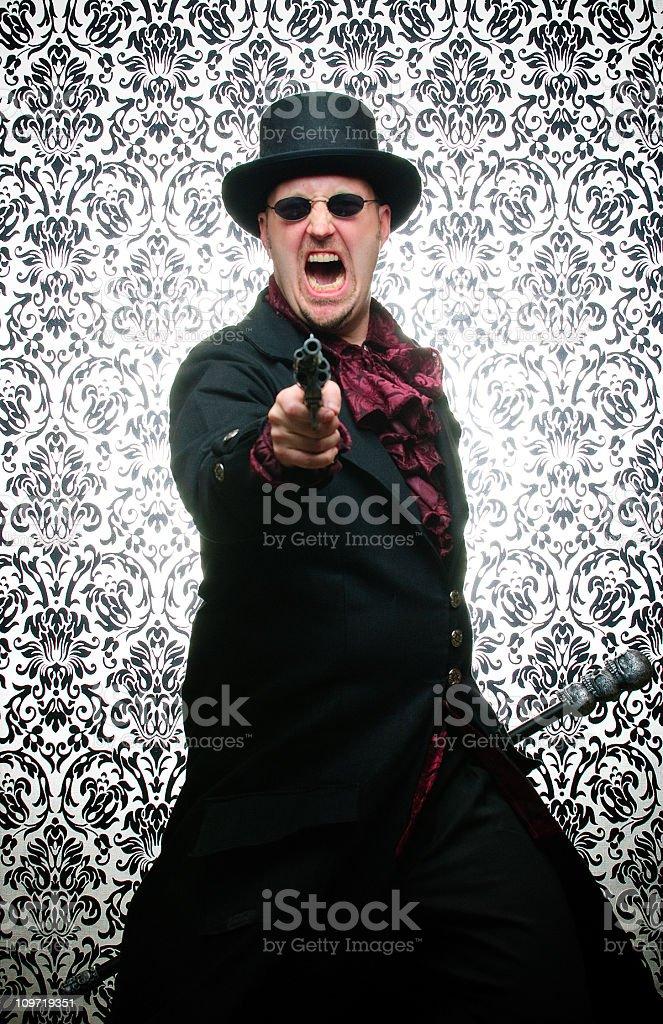 Steampunk Man Pointing Gun Against Damask Background stock photo