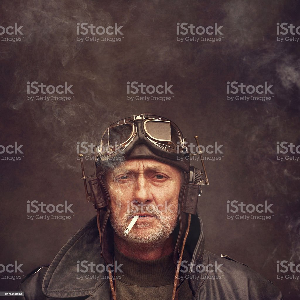 steampunk senior man wearing headphones and goggles stock photo