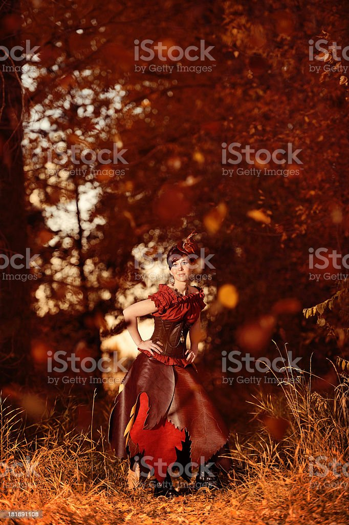Steampunk Woman In Forrest Of Falling Leaves - Autumn's Arrival royalty-free stock photo