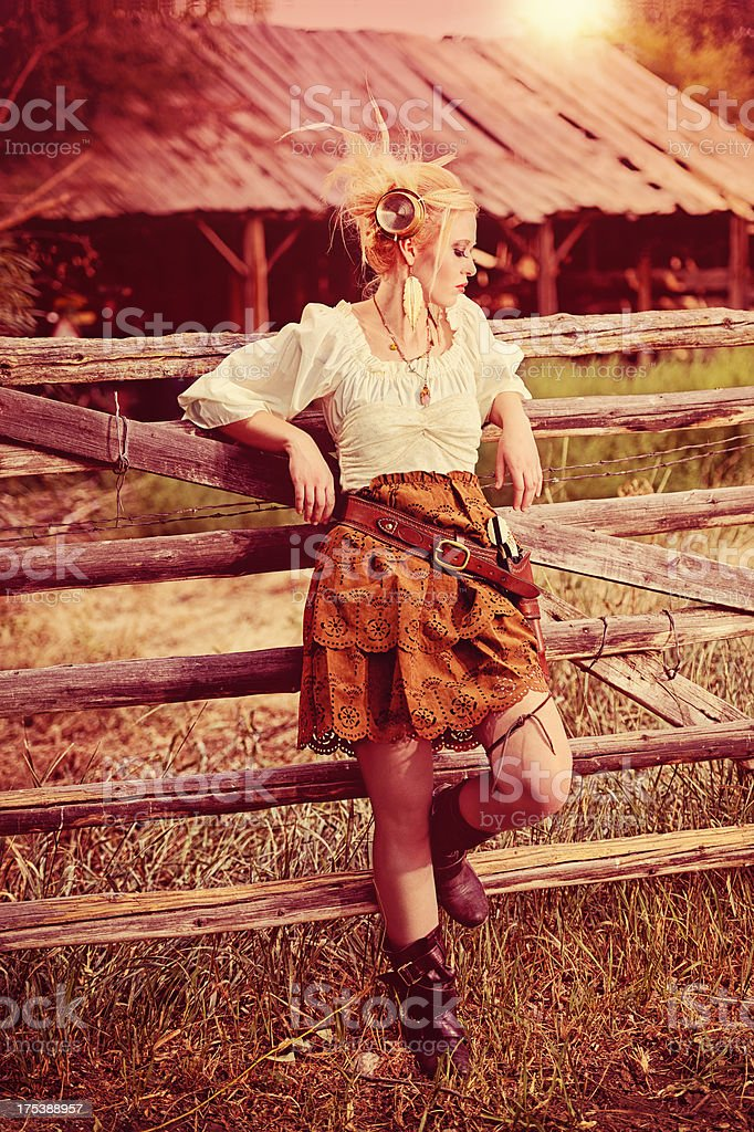 Steampunk Woman With Paranormal Meter and Holster In Evening Light stock photo