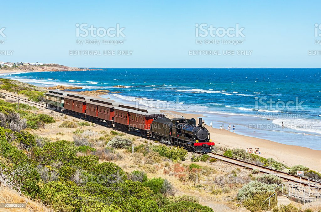 SteamRanger's steam-hauled Cockle Train in picturesque coastal scenery stock photo