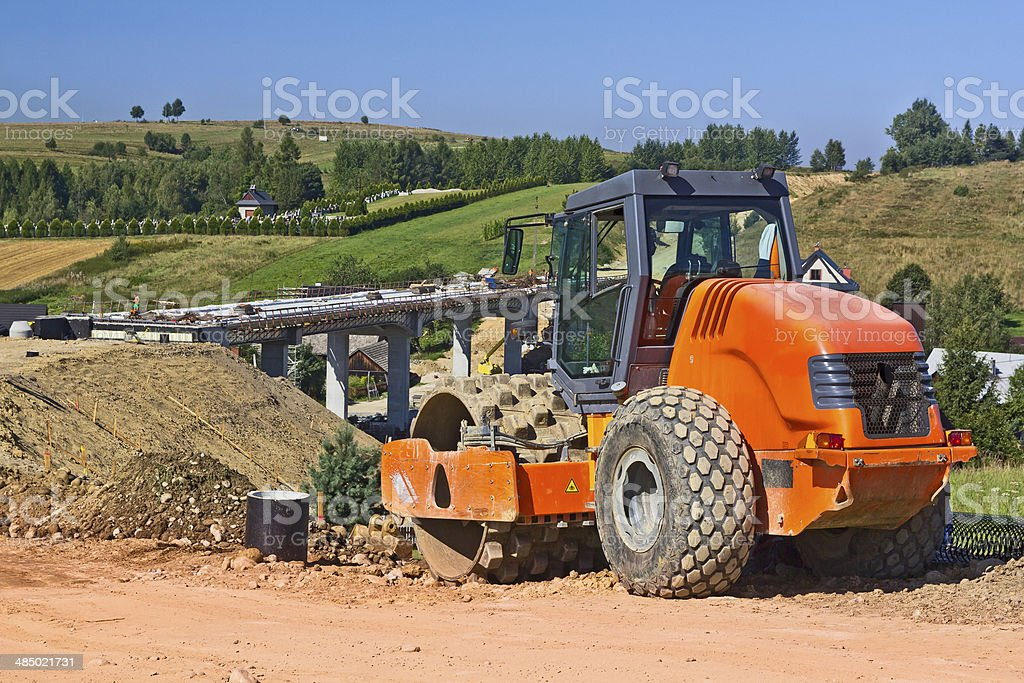 Steamroller on a new road construction royalty-free stock photo