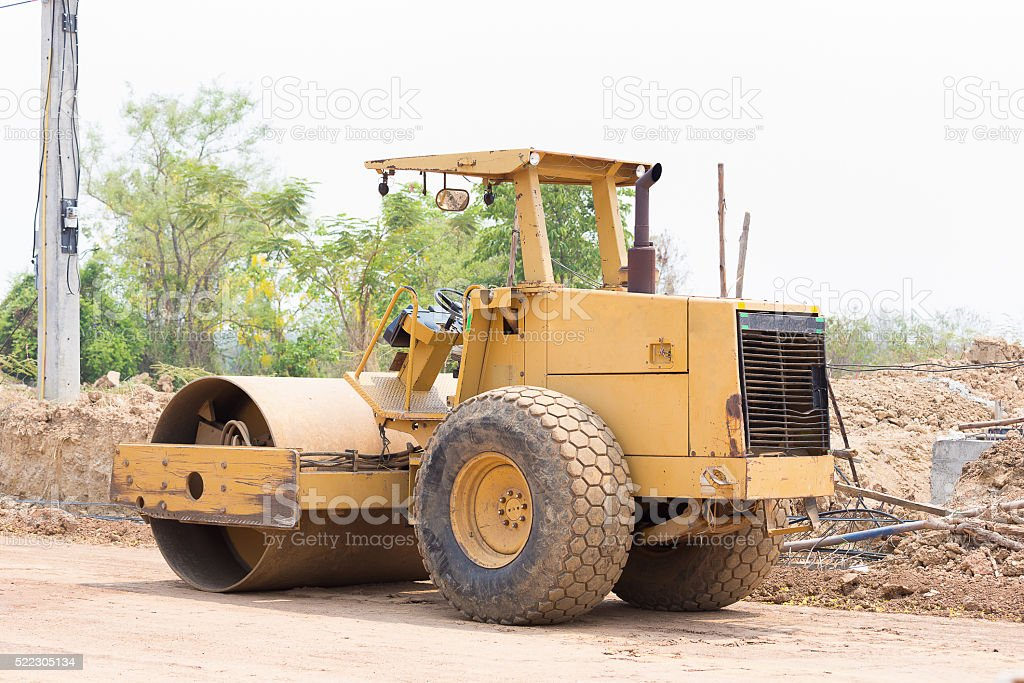Steamroller working at a construction site stock photo