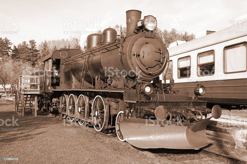 Steamtrain at the station (sepia) royalty-free stock photo