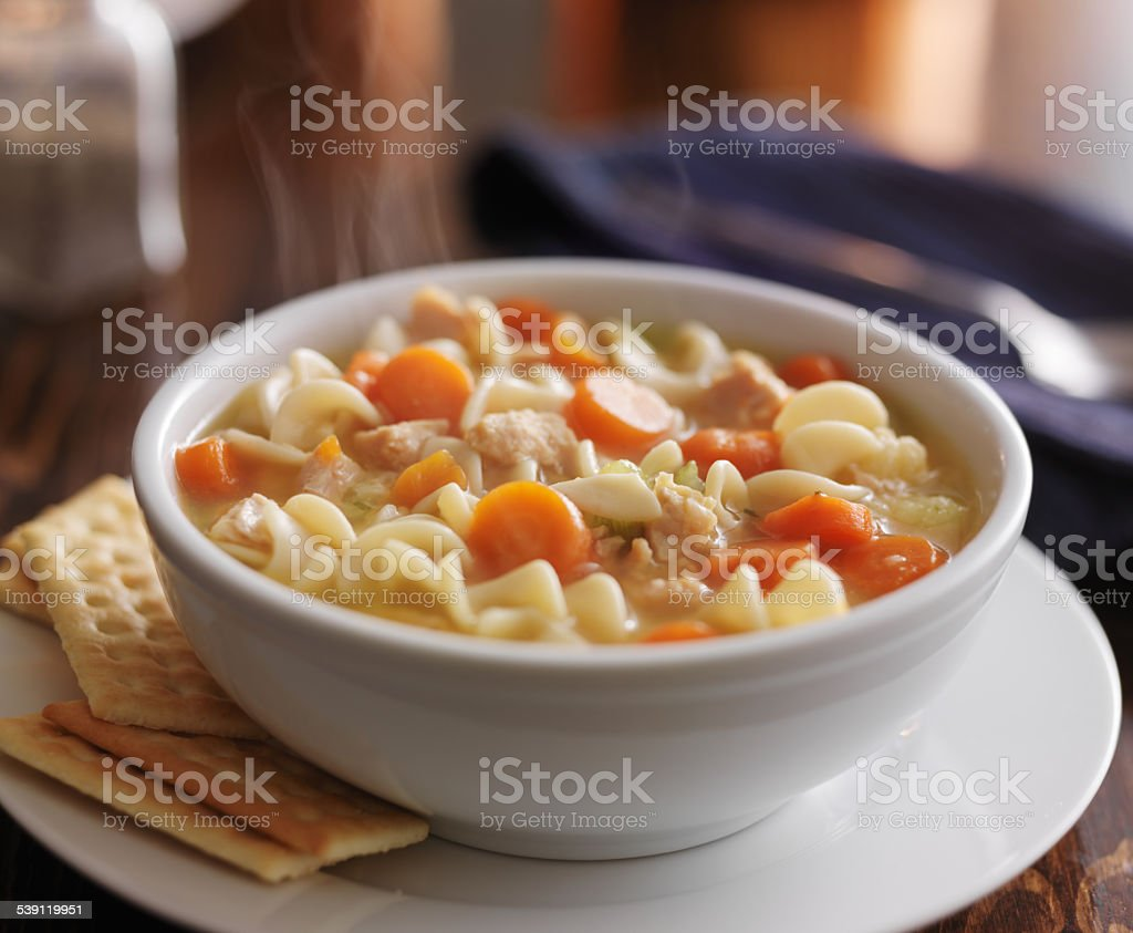 steamy bowl of chicken noodle soup stock photo
