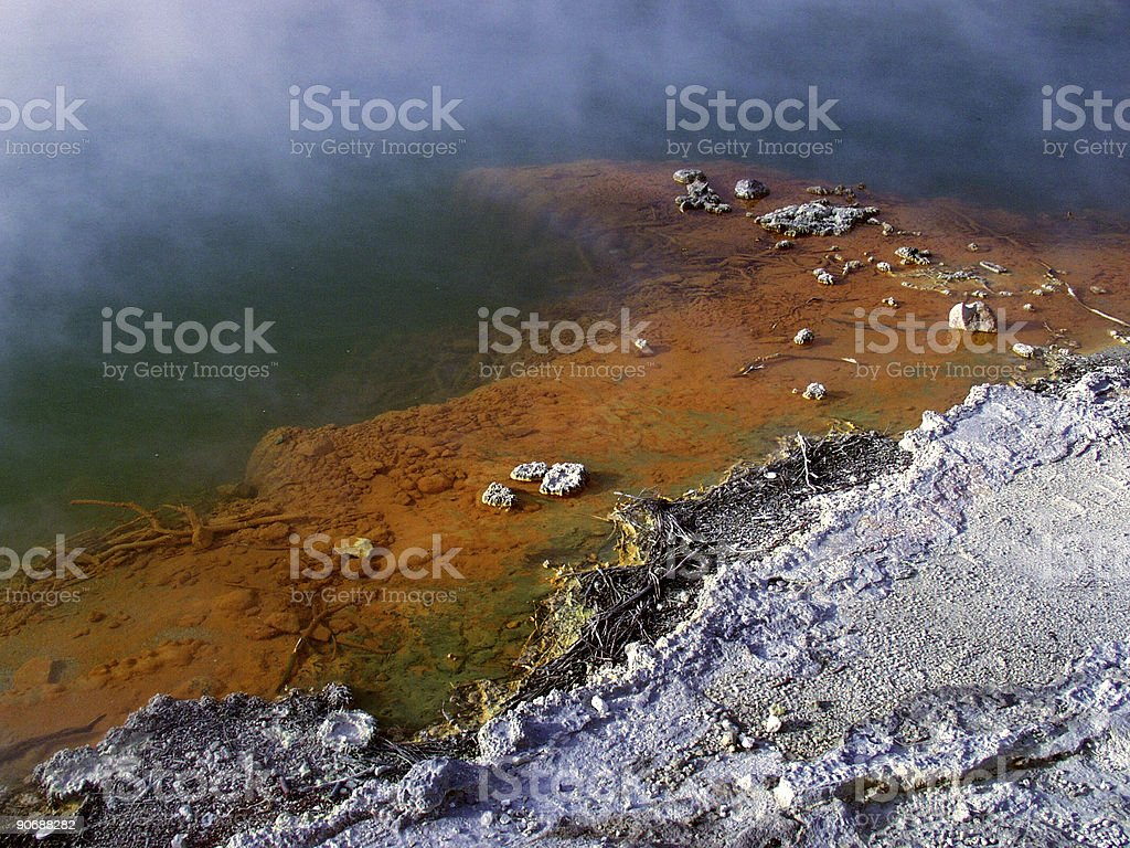 Steamy thermal pond with bright red edge royalty-free stock photo