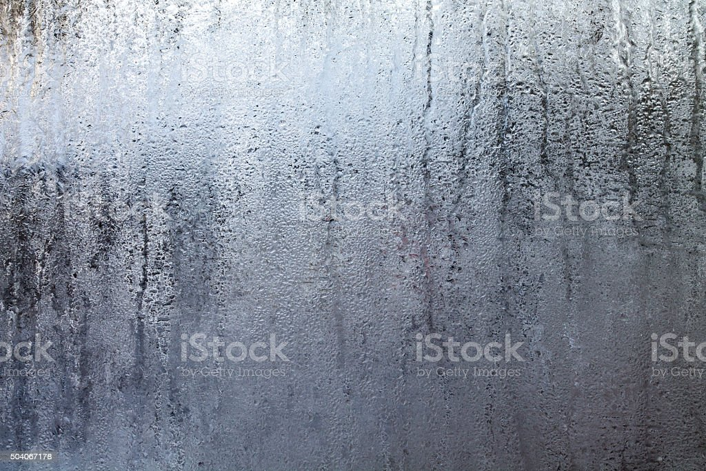 Steamy Window with Water Drops stock photo