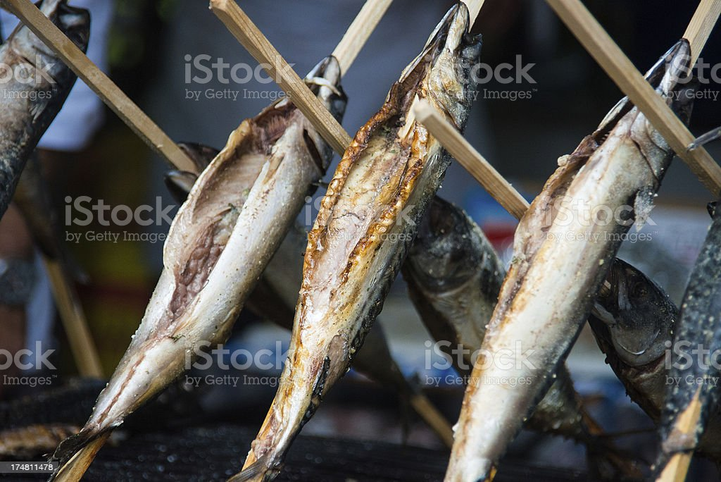 steckerlfisch - grilled fish on octoberfest royalty-free stock photo