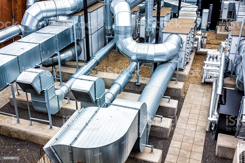 Steel air conditioning devices on the building roof stock photo