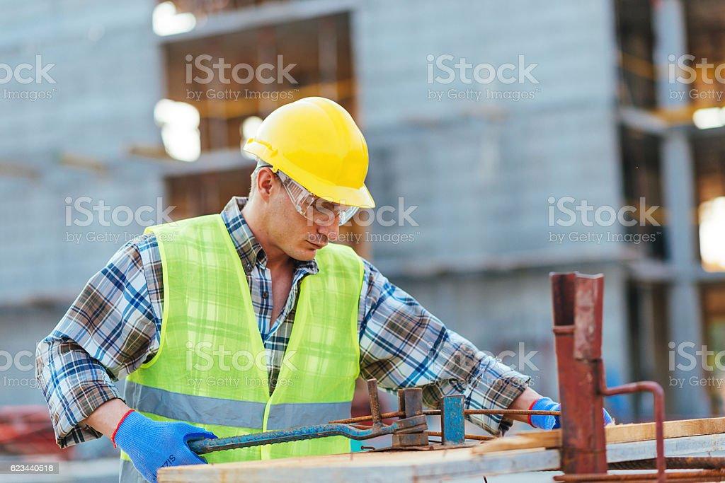 Steel armature bending on construction platform stock photo
