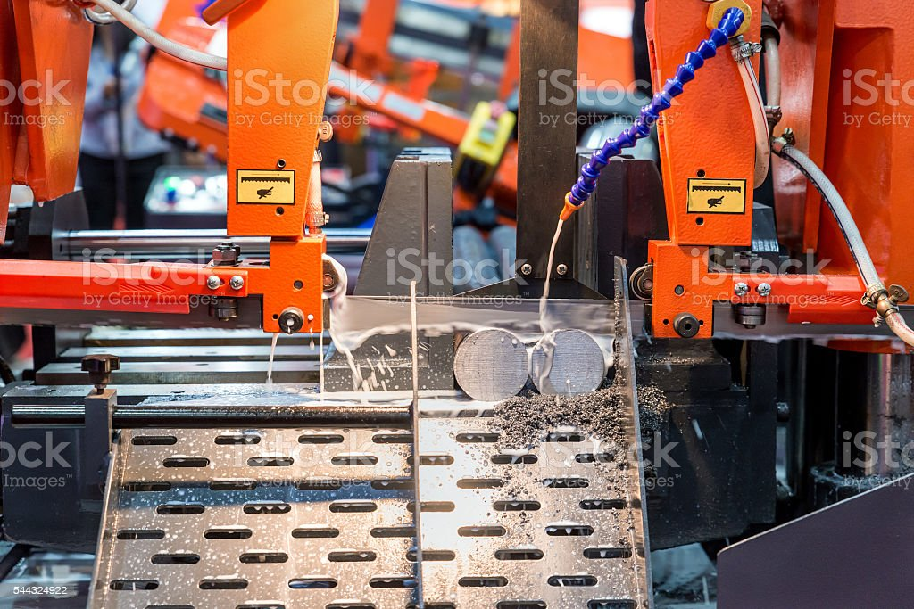 Steel band saw machine working in industry factory. stock photo