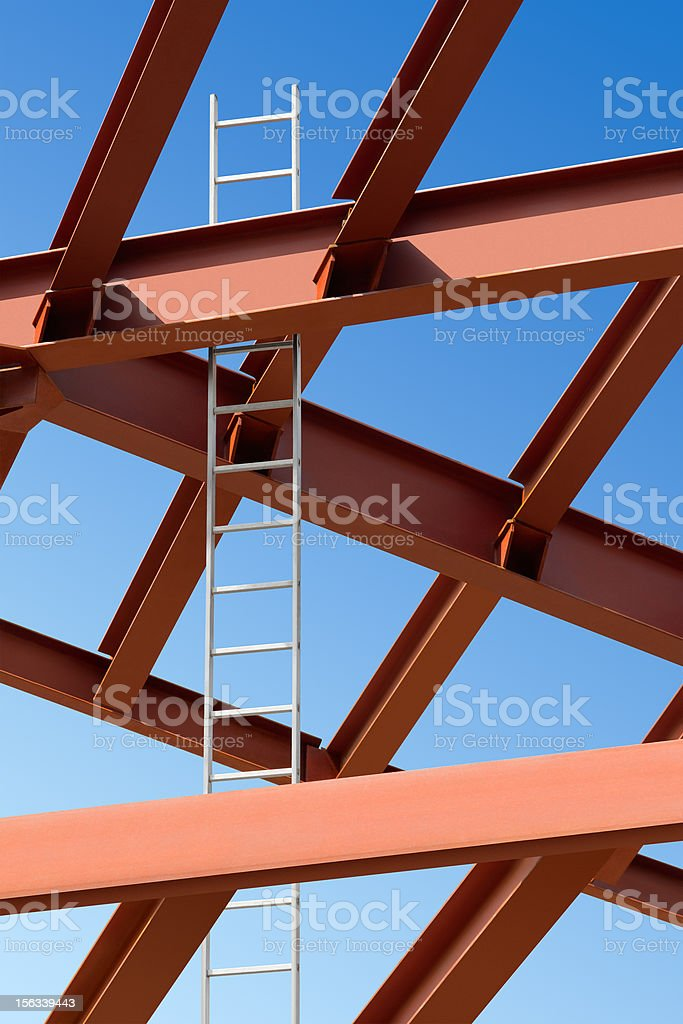 Steel beams and ladder against the blue sky. royalty-free stock photo