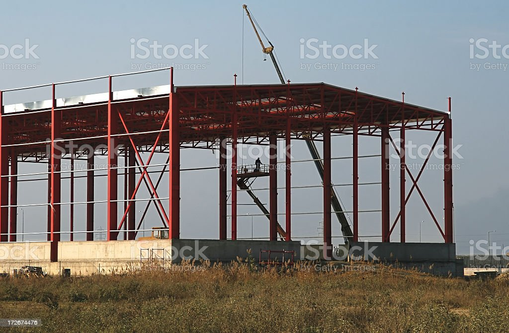 A steel building frame on a construction site royalty-free stock photo