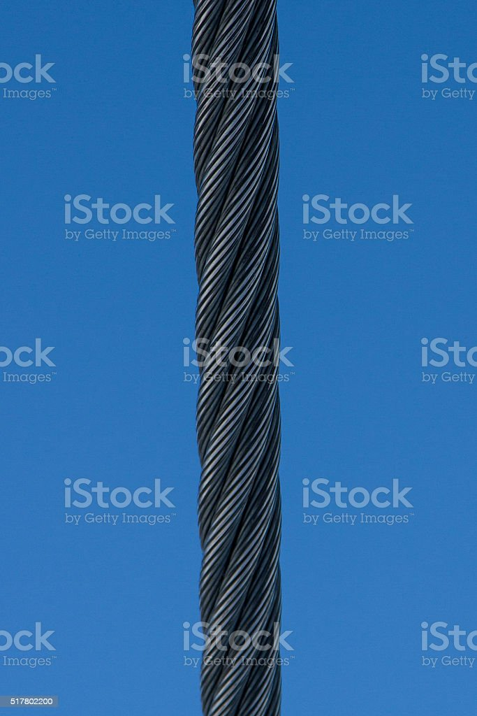 steel cable on a background of blue sky stock photo