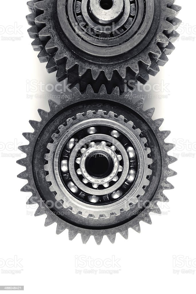 Steel cog wheels and transmission machine teeth on isolated background royalty-free stock photo