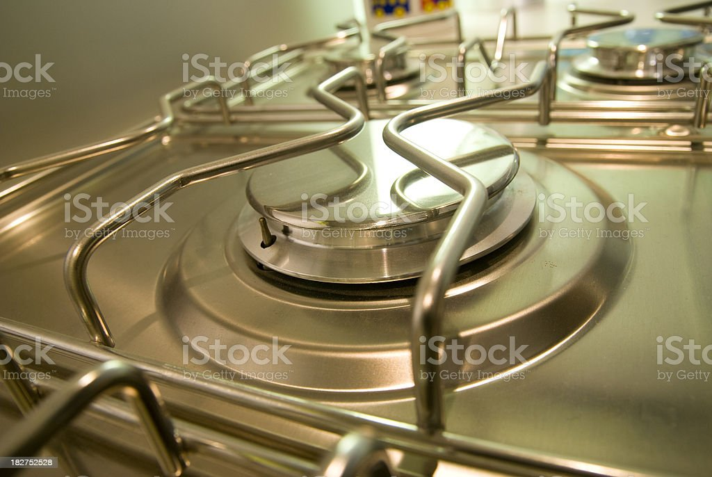 Steel cooker cooking in a empty kitchen royalty-free stock photo