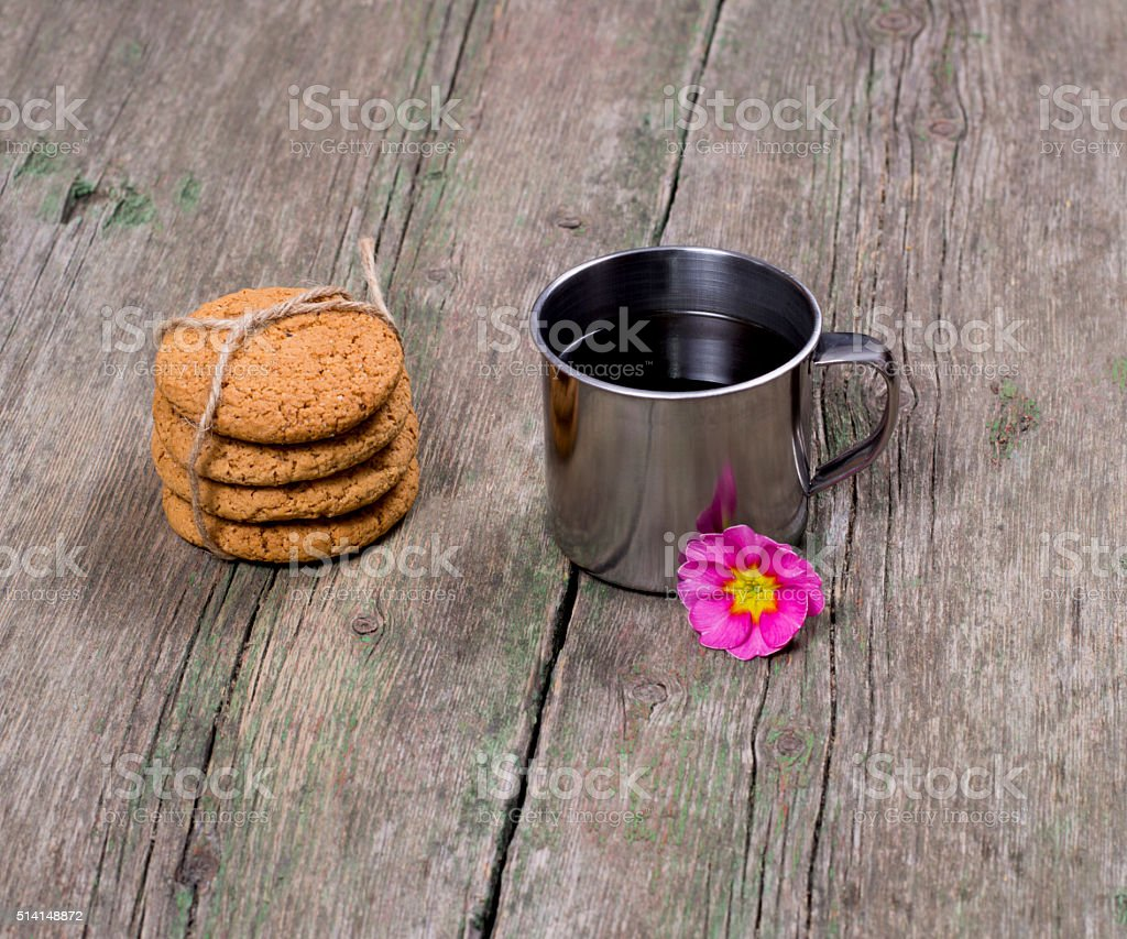 steel cup of coffee decorated with a flower stock photo