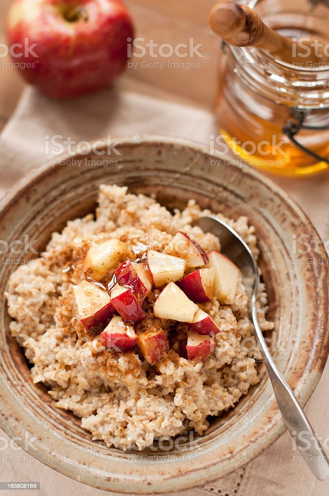 Steel cut oatmeal with apple, honey and cinnamon stock photo