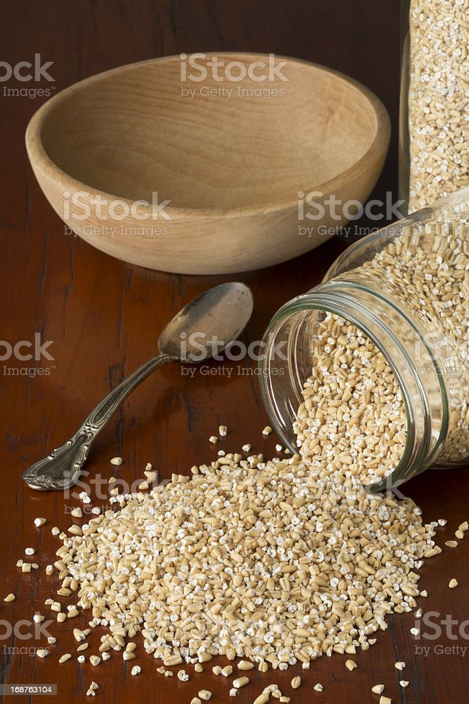 Steel Cut Oats Spilling from Glass Canning Jar royalty-free stock photo