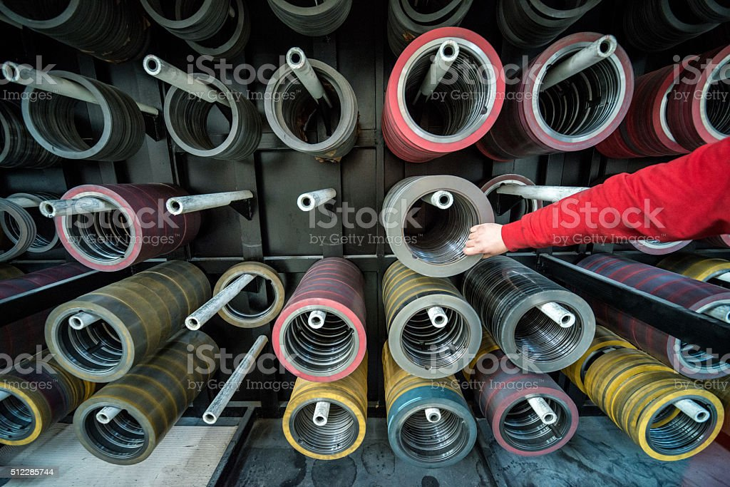 Large group of steel cylinders which used in cnc machines in...