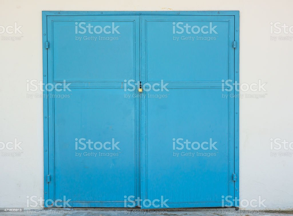 steel door and padlock on white wall royalty-free stock photo