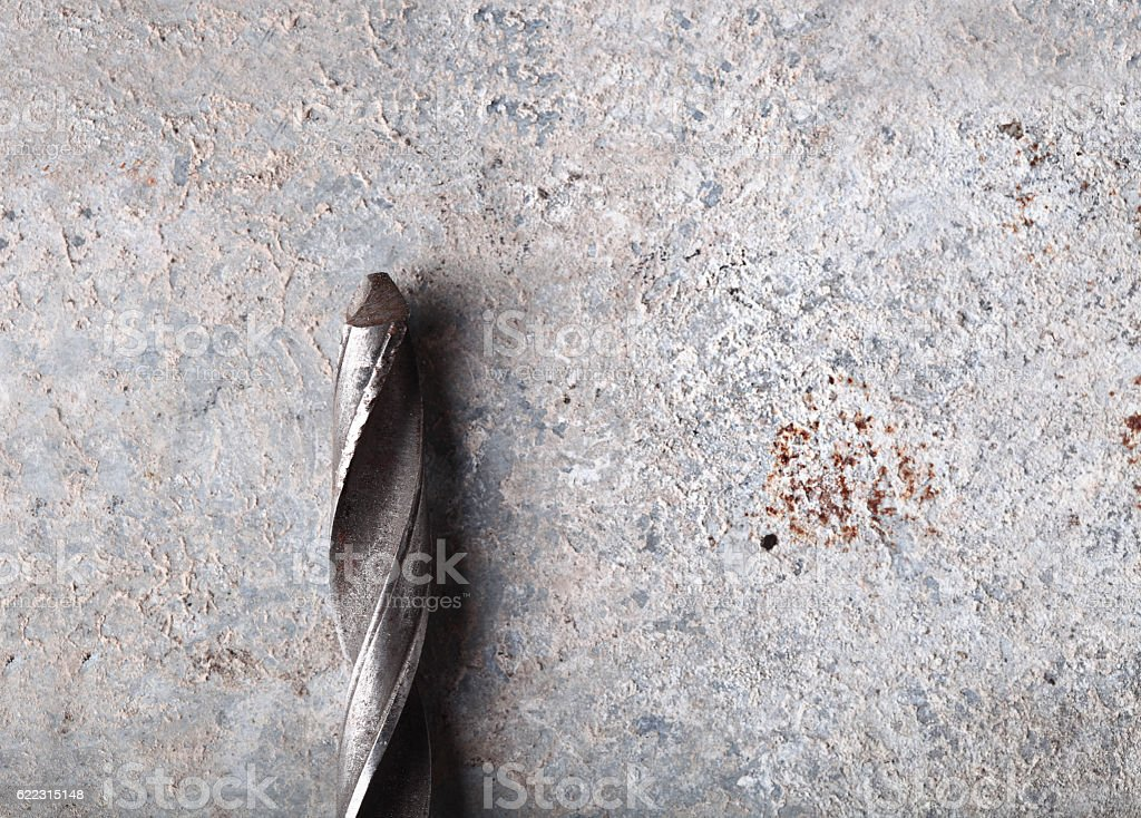 Steel drill on grunge background stock photo
