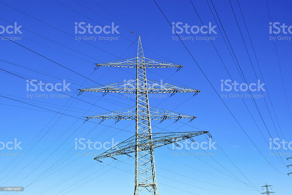 Steel electricity pylon on bright blue sky royalty-free stock photo