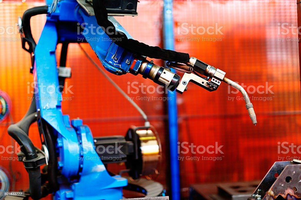 Steel fabrication plant: detail of robotic welder stock photo