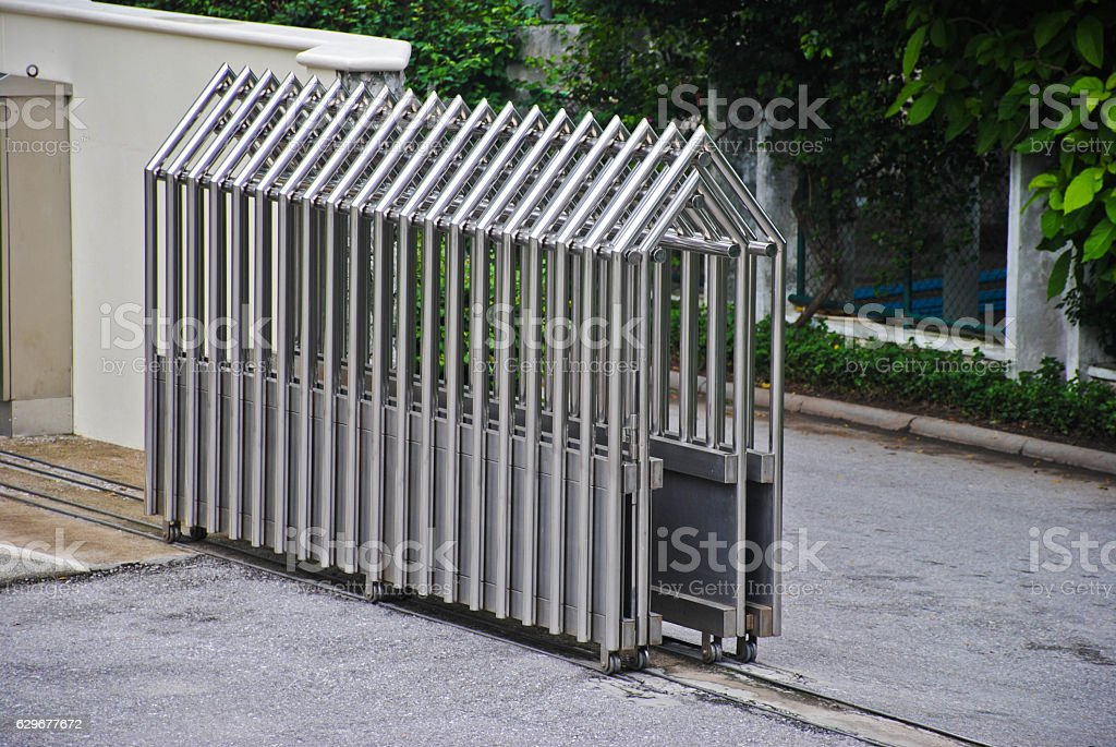 Steel Gate Fence Building Parking area Building Outdoor stock photo