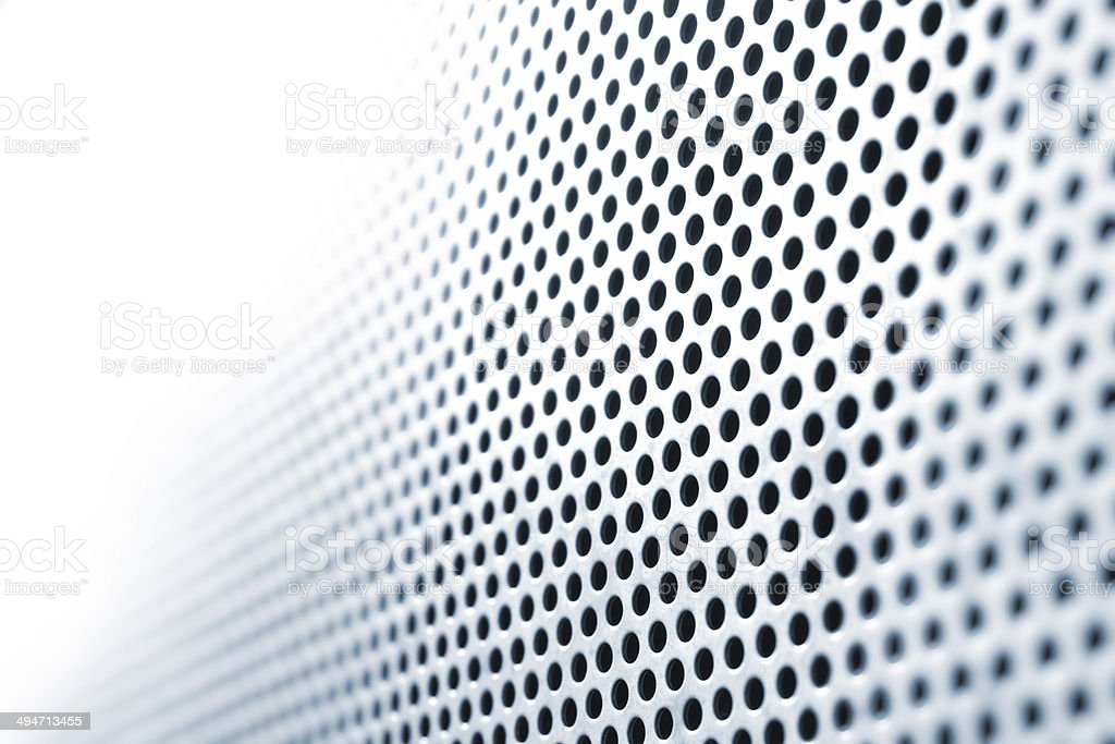 Steel Grid Circle Holes in Focus Shift stock photo