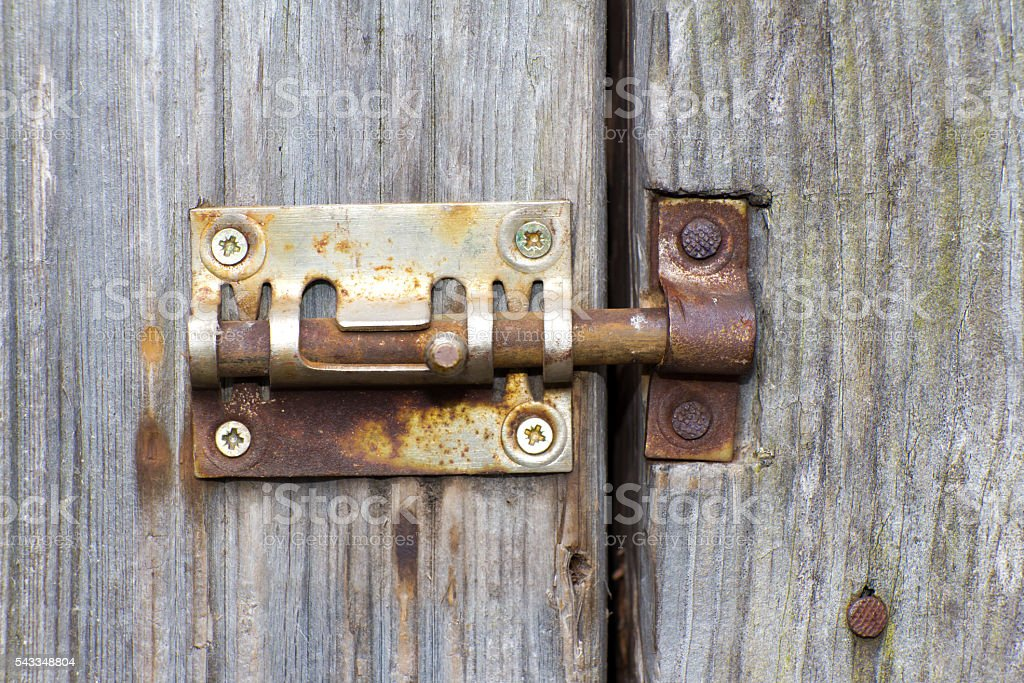 Steel lock of iron corroded by rust. Very old. Strong stock photo