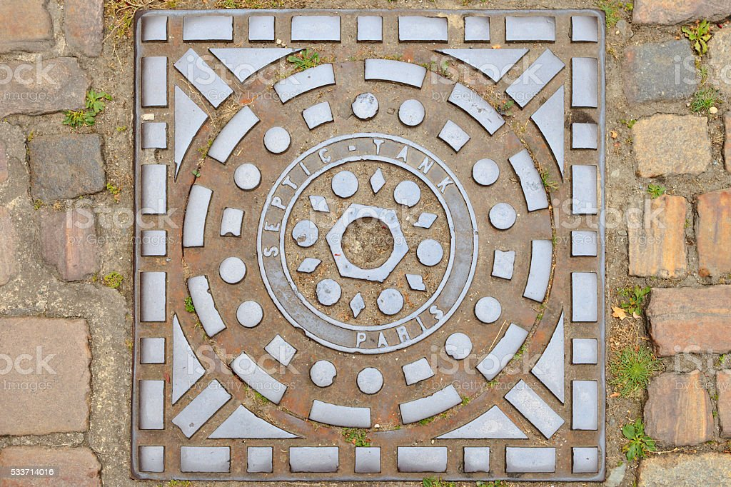 steel manhole cover from Paris stock photo