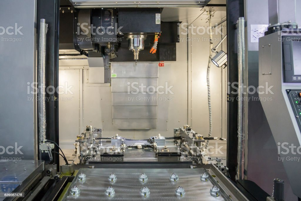 Steel metal automotive parts cutting machine process by CNC stock photo