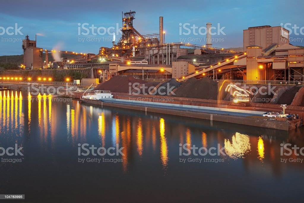 steel mill at night stock photo