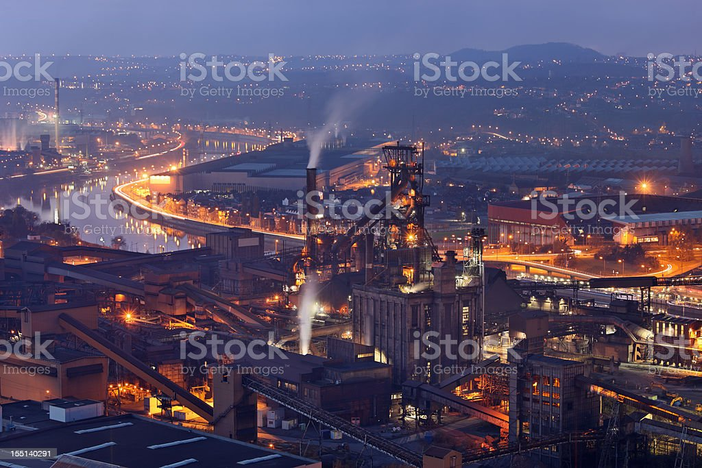 Steel mill at night stock photo